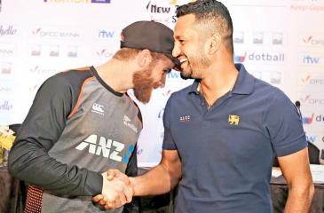 New Zealand cricket captain Kane Williamson (left) and his Sri Lankan counterpart Dimuth Karunaratne greet each other at the launch of their Test and T20 series (Pic by Rukmal Gamage)