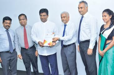 ICTA Chairman Prof. Rohan Samarajiva presents the IT-BPM Workforce Survey 2019 Report to Digital Infrastructure and Information Technology Non-Cabinet Minister Ajith P. Perera.