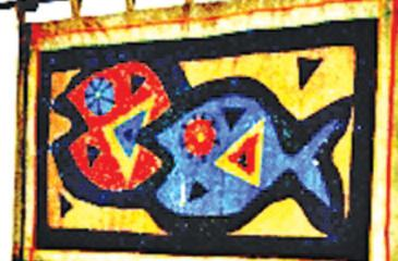 An applique wall hanging using fabric on jute