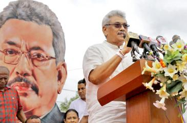 SLPP Presidential candidate Gotabaya Rajapaksa with a menacing cut-out looming behind