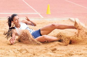 Army athlete HDV Lakshani makes a long jump to victory with a distance of 6.23 metres at the 97th Athletic Nationals at the Sugathadasa Stadium in Colombo yesterday (Pix by Ranjith Asanka)