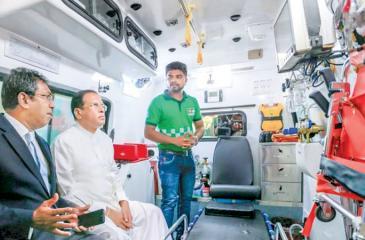 President Maithripala Sirisena and Subject Minister Dr Harsha De Silva inspecting a 1990 ambulance.