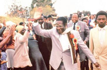 Zimbabwe's Robert Mugabe waves, attends an election rally near Harare, in July 1985. His Zanu Party won a landslide victory in the country's first election since independence