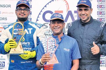 Ushan Perera and Malika Kuruwitaarachchi with CEAT Racing Team Manager Jayalath Hemantha