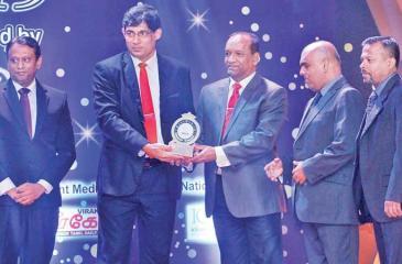 A Right Aqua official receives the Silver award.