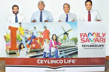 Ceylinco Life Chairman R. Renganathan and Managing Director Thushara Ranasinghe (second and third from left) with the Company's General Manager – Marketing Samitha Hemachandra (extreme right) and Brand Manager – Marketing Chamath Alwis at the launch of the latest Family Savari promotion.