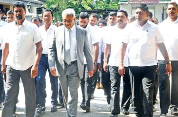 Gotabaya Rajapaksa walks out of the Special High Court in Hulftsdorp surrounded by bodyguards.  Pic courtesy: RepublicNext