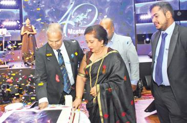 (From left:) Chairman, Master Divers and W. A. Tucker, Ariyaseela Wickramanayake,  his wife, Director Operations Akmal Wickramanayake, Executive Director Toshan Wickramanayake at the  ceremony to celebrate the firm's 40th anniversary.