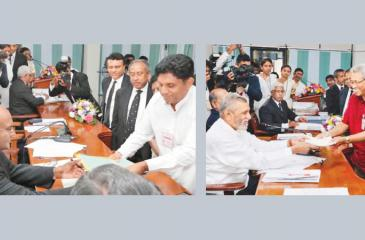 Democratic National Front candidate Sajith Premadasa and Sri Lanka Podujana Peramuna candidate Gotabaya Rajapaksa handing over nominations for the presidential election.