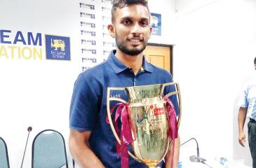 Country boy Dasun Shanaka the captain poses for the media with the prized trophy
