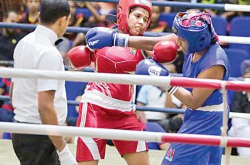 Air Force women's boxer WAK  Thiwanka (red) and Heshani Perera (Thuruli) exchange punches during their Light Welter (64kg) weight final at the Clifford Cup Boxing Championships at the Royal MAS Arena on Friday night. Thiwanka won the bout (Picture by Shan Rambukwella)