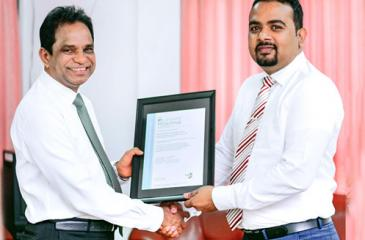 Dr. B. M. S. Batagoda presents the certifications to Director of Sustainability, Research and Development, Thusitha Bandara.
