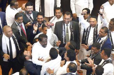 Members of the Sri Lankan parliament shout slogans in support of then ousted prime minister Ranil Wickremesinghe during a parliament session on November 14, 2018. Pic courtesy Lakruwan Wanniarachchi/AFP