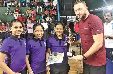 Sandilma Suheli, Buthmi Bandara and Pramukshi Fernando with Sri Lanka coach from Belarus Aleksey Yefremov