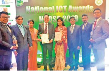 The SriLankan IT team with the two awards