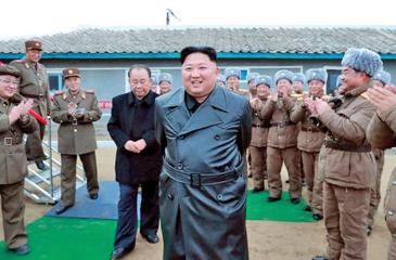 "A state media image said to show Kim Jong-un inspecting the testing of a ""super-large multiple-rocker launcher"""