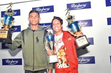 Best athletes M Kaushan (left-De Mazenod College) and Seneka Gunaratne (CIS Kandy)