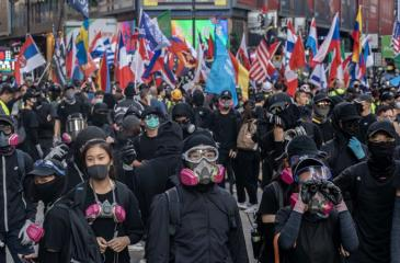 Protestors wearing masks.