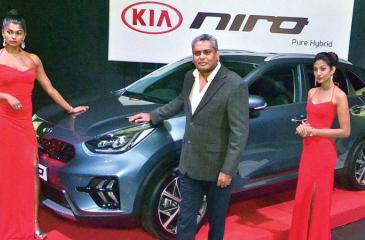 Kia Motors (Lanka) Limited Managing Director Mahen Thambiah with the 'Kia Niro'. Pic: Vipula Amerasinghe