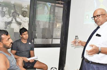 Sri Lanka rugby players Sajith Saranga (CH and FC) and Riza Riffaideen (CR and FC) listen to a lecture given by Dr. Seevali Jayawickrema, the head of anti doping