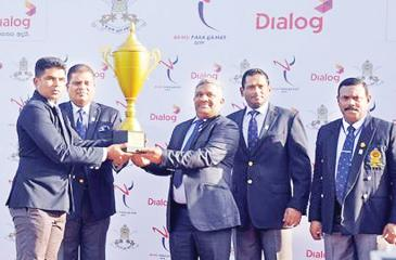 Major Anura Tennakoon of the Sri Lanka Light Infantry Regiment receiving the award for the overall champion at the Army Para Games 2019 from KDS Ruwan Chandra the Secretary of the Ministry of Sports in the presence of Army commander Lt Gen Shavendra Silva