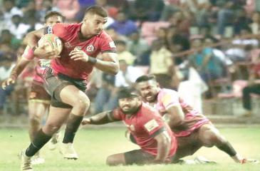 CR centre Dinuk Amarasinghe makes a break as his team mate Omalka Gunaratne falls to the ground along with  Havelocks defender Dinushan Ariyapala (Pic Shan Rambukwella)