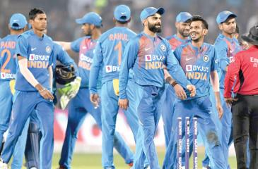 India's players celebrate after winning the third T20 cricket match against Sri Lanka at the Maharashtra Cricket Association stadium in Pune on January 10 AFP