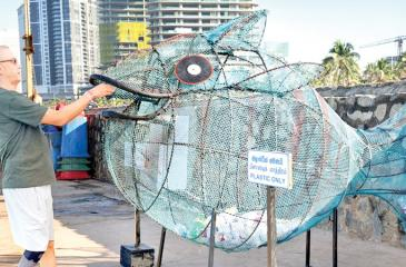 Garbage bin shaped like a fish at Galle Face Green