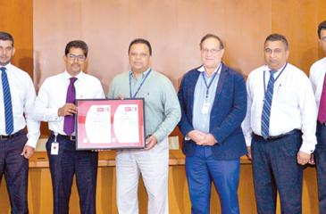 HNB and Bureau Veritas Lanka officials at the presentation of the ISO certification.