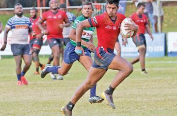 Janidu Dilshan of CR makes a break against Navy  (Pic by Shan Rambukwella)