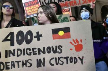 Protesters highlighting Aboriginal deaths at the Black Lives Matter protest in Sydney