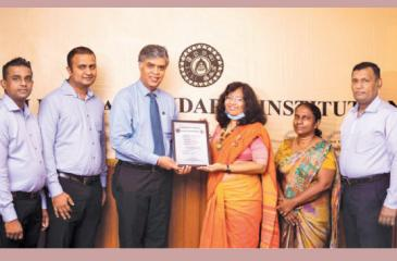 Charitha Subasinghe President Retail, John Keells Group (third from left) receives the  Certificate from Dr. Siddhika G. Senaratne, Director General,   Sri Lanka Standard Institution (fourth from left).