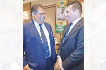 Outgoing rugby chief Lasitha Gunaratne (left) and Rizly Illyas share a moment