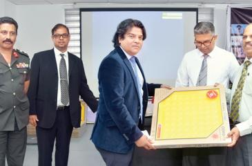 Edgeng Lanka Directors  Shihan Ganegoda and Don Sidantha Ganegoda present the foot sanitising trays to the officials of the Department of Immigration and Emigration, the Department of Registration of Persons and the Ministry of Defence. (Pic: Samantha Weerasiri)