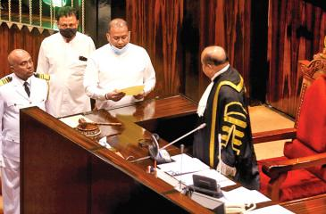 Premalal Jayasekera takes oaths as an MP before the  Speaker on September 8.  Pic: Sulochana Gamage