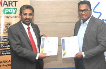 General Manager of BOC, Sugath Gunasekara (left) and Chief Executive Officer of SLT, Kiththi Perera exchange  the agreement.