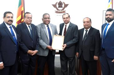 Director General of Civil Aviation, Capt. Themiya Abeywickrama presents the Aviation Security Service Provider Licence to Chairman, AASL, Maj. General (Rtd.) G. A. Chandrasiri at CAASL headquarters, Katunayake. Vice Chairman, CAASL, Amitha Wijayasuriya, Actg. Additional Director General CAASL, P. A. Jayakantha, Vice Chairman, AASL, Rajeewasiri Sooriyaarachchi, senior officials of CAASL, AASL and Aviation Security stakeholders including State Security agencies and industry were also present.