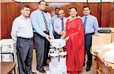 Health Minister and CEAT officials at the donation of equipment.