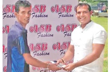 PIW Jayasekara a senior Ccicket coach receiving an official T-shirt and Membership card from Asanka Prasad, Director of ASB Fashion