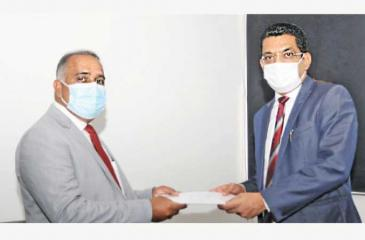 Minister of Justice Ali Sabry PC presents the appointment letter to Attorney-at-Law Ganesh R. Dharmawardana