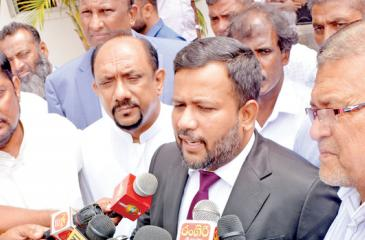 File picture of Rishad Bathiudeen with the media.