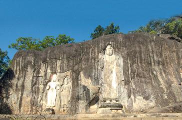 The magnificent seven rock-hewn statues at Buduruwagala rock in Wellawaya