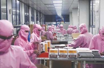 A worker at the Hindustan Syringes factory at Faridabad (AFP)
