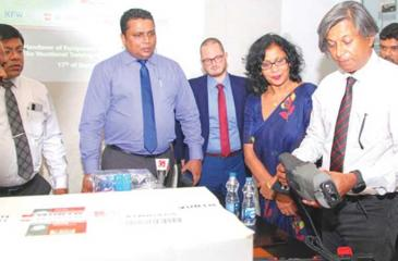 Wurth Managing Director Rohan Amirthiah takes a close look at a chop saw. Chairman, VTA, Damitha Wickramasinghe (centre) and officials look on.