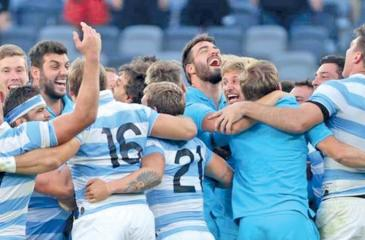 The triumphant Argentina players celebrate victory over New Zealand