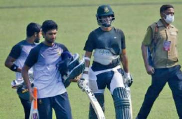 Shakib Al Hassan is escorted by an armed guard
