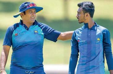 Hashan Tillekeratne talks to a young player