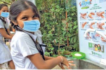 Schoolchildren of Sapugaskanda Sobhitha Vidyalaya (Primary) taking part in awareness  activities