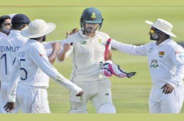 Sri Lankan fielders give South African century maker Faf du Plessis a congratulatory walk-back after they waited till he made 199 and lose his wicket in the first cricket Test last week