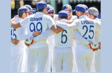 The Indian team huddle together before taking the field for the final session of the third day of the third cricket Test against Australia in Sydney